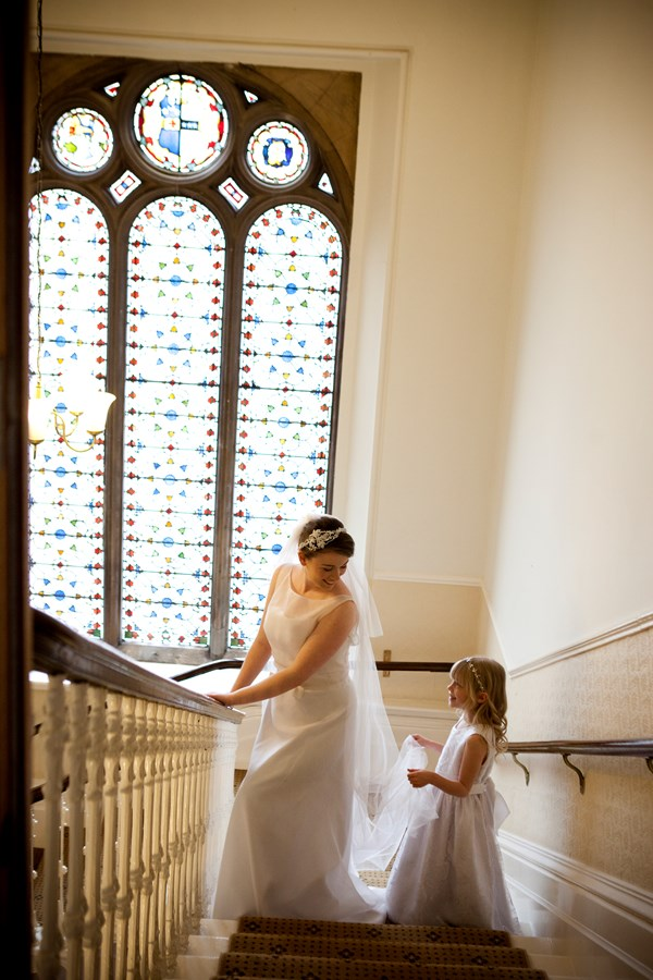 Bride and bridesmaid on the stairway