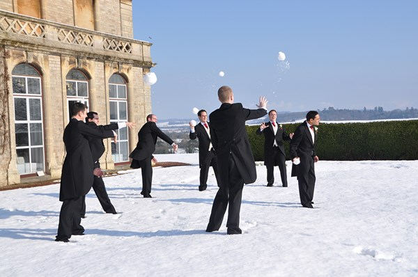Wedding guests playing in the snow